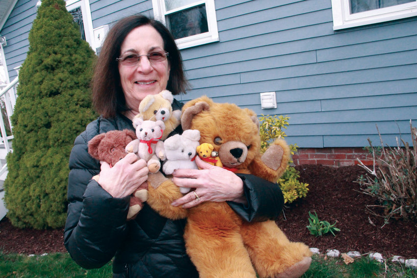 GETTING HER ARMS AROUND IT…BEARLY: Conimicut Village Association president Ginny Barham put out a notice to the neighborhood of the bear hunt…and she had plenty from her collection to position in her windows.