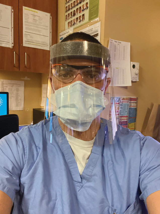 TAKING WORDS TO HEART:  Dr. Luke Messac, seen here geared up for work at Rhode Island Hospital, recently shared a 13-year-old email response from NIH Director Dr. Anthony Fauci. Fauci praised Messac's thesis and said he was confident he would go on to have a successful career. (Submitted photo courtesy Luke Messac)