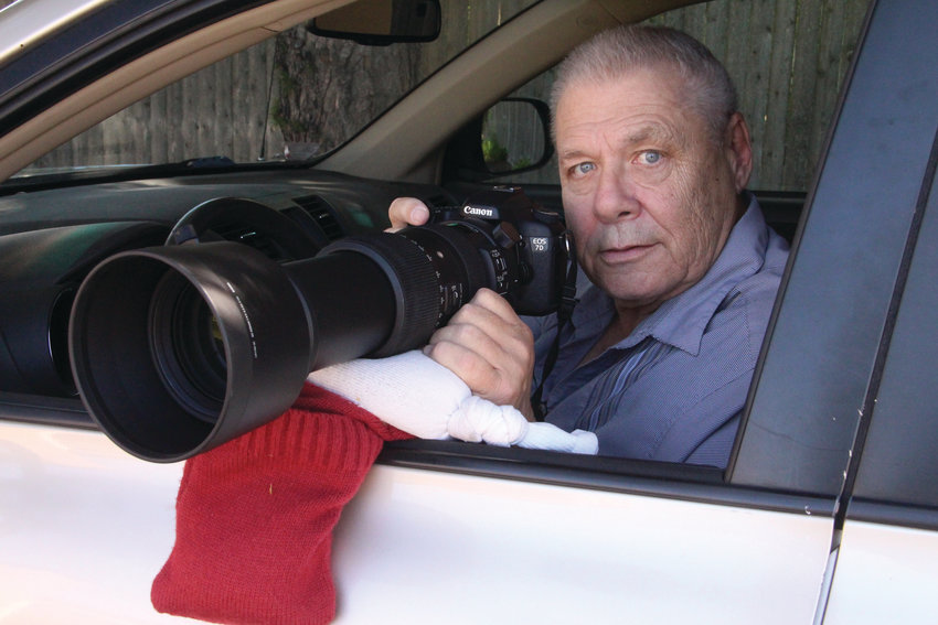 FROM A BAG OF BEANS: David Chartier perches his Canon outfitted with a 60 to 600mm Sigma lens on his car window. He uses a bag filled with beans or rice as a stabilizing platform.