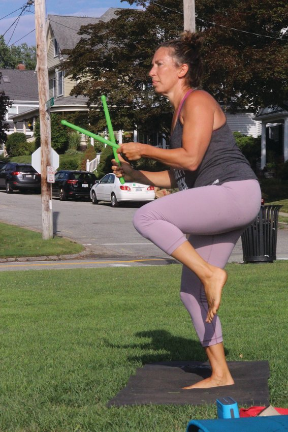 DRUMMING UP A FOLLOWING: Instructor Selene Byron, who conducts the pound program at Edgewood Fitness for Women, sets a vigorous pace for  those participating in the hour-long session held Saturday at Stillhouse Cove. The weekly fitness training, weather petmitting,  involves the use of sticks that set a rhythm and cadence for the exercise program as well as bringing curious  looks from those passing by.