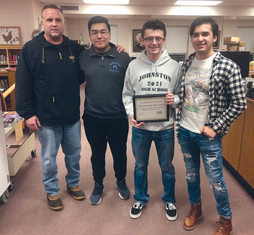 DRIVE TO SUCCEED: Rhode Island Blood Center account manager Glenn Halvarson (far left) stopped by the Johnston School Committee meeting in December to present, from left to right, Caleb Lee, Nick Petrillo and Carlos Fragoso with a certificate honoring Johnston's second-place status among R.I. high schools. (Sun Rise photo)