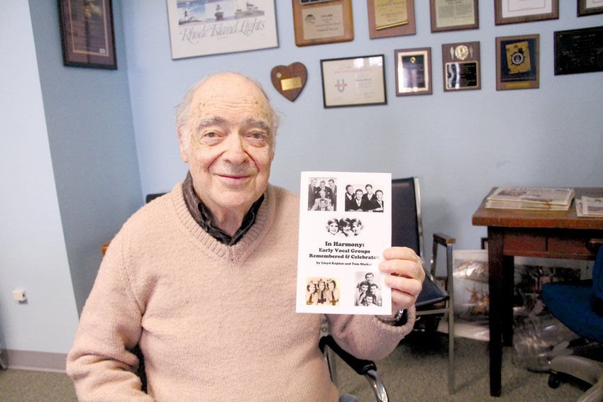 """SHARING HIS PASSIONS: Lloyd Kaplan is pictured with a copy of his newest book, """"In Harmony: Early Vocal Groups Remembered & Celebrated,"""" which was co-authored by Tom Shaker."""