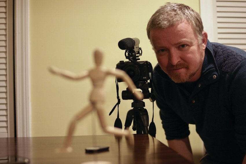 "MAKING MOVIES: Robert Isenberg shot the footage for his short film ""Mannequin"" in the space of roughly two hours at his Cranston home office. ""I was so into it that by the time I was done, I was like, 'Wow, I can't believe I'm done,'"" he says."