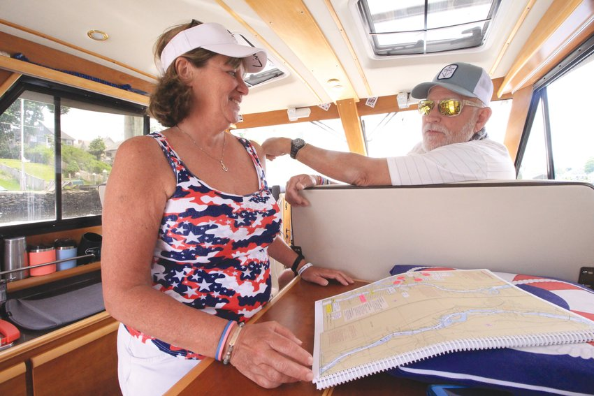 CLOSE QUARTERS: Every square inch of the boat has a purpose. There's even a place for Marie's spreadsheets and charts that have been carefully highlighted with stickers to remind the two of them places and people they want to see on their trip.