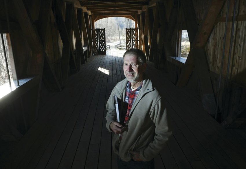"""MEET THE AUTHOR: Martin Podskoch, author of """"Rhode Island 39 Club"""" and """"Rhode Island Conservation Corps Camps,"""" is pictured on Comstock's Bridge in East Hampton, Connecticut."""