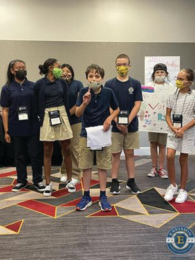LADIES AND GENTLEMEN, YOUR NEXT PRESIDENT: Ryan Golditch and his campaign team work on getting him elected president at the Envision Junior National Young Leaders Conference in July.