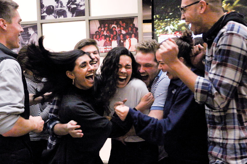Roxboro native Ashton Martin (center) and her friends cheer as they hear she will be the next student body president for the University of North Carolina at Chapel Hill..