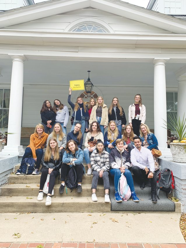 The students from Siegburg pose in front of the Person County Museum of History.