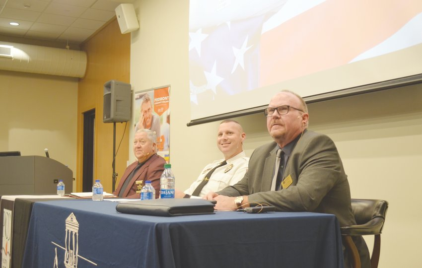 From left to right: Sheriff Dewey Jones, Chief David Hess and Dr. James Hodgson served on the panel at the Town Hall Criminal Justice Forum at Piedmont Community College Tuesday night.