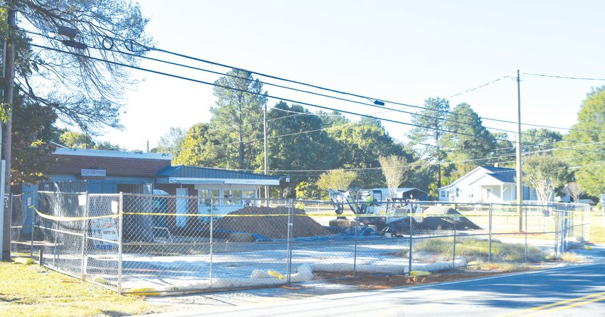 Workers work on the the cleanup of the GMH Electronics site at 1800 Virgilina Road Friday morning.