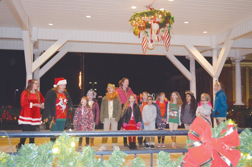 Ushering in the season.Singers gather under the gazebo prior to their performance at the 2018 Jingle on Main. This year's event is slated for Thursday, beginning at 5 p.m. There will be music, hay rides, free movies and the traditional lighting of the town Christmas tree.