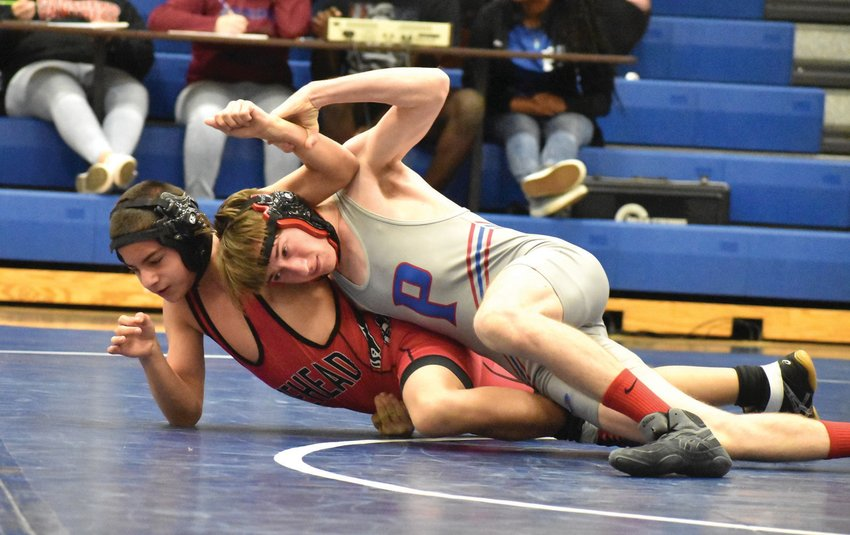 Person's Logan Bates, shown here during a win earlier in the season, won both of his matches during Saturday's Jim Coggins Hall of Fame Classic at Southwest High School. The Rockets won all three duals. KELLY SNOW   COURIER-TIMES
