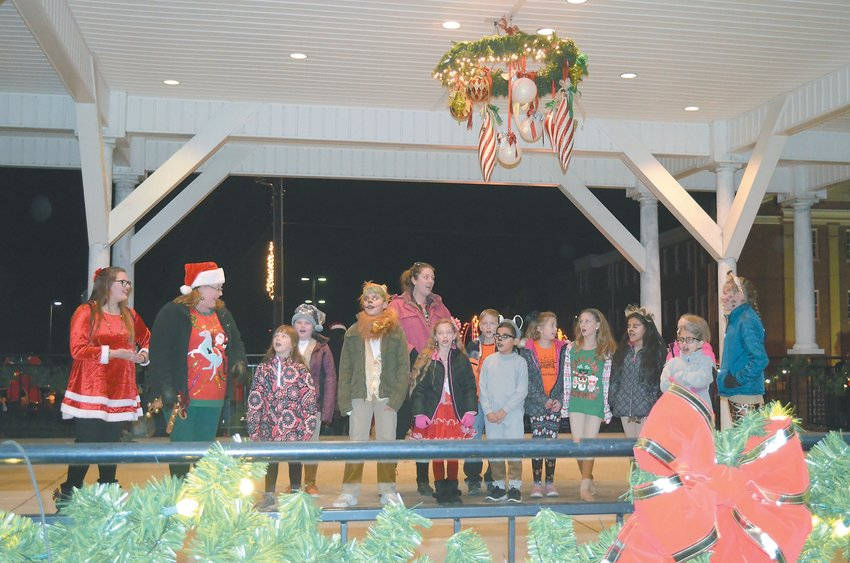 Carolers sing Christmas Carols at the Gazebo for Jingle on Main. The annual event drew hundreds of people to Uptown Roxboro to kick off the Christmas season. Photos by Daniela Gamboa | courier-times