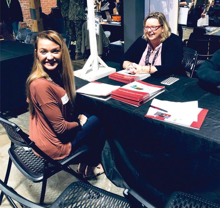 Person High School Senior Cassandra Abdelrahmen speaks with Laura Burton from Burton Realty. SUBMITTED