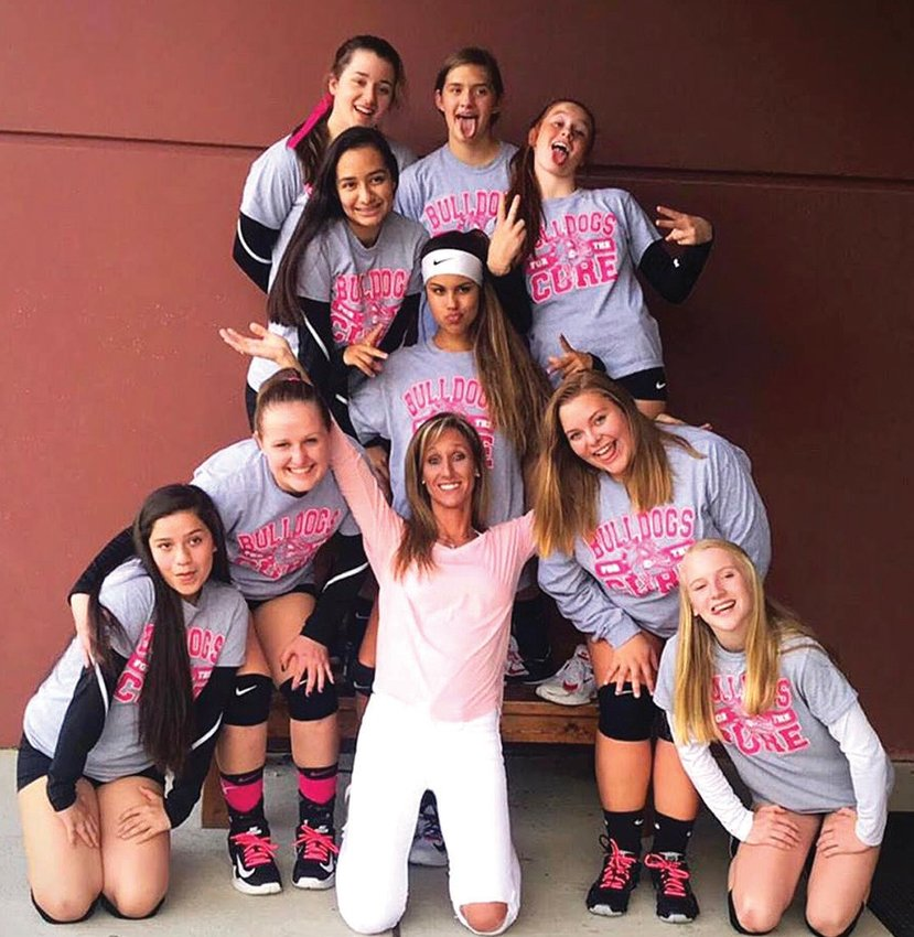 The RCS high school JV volleyball team prayed with Oxford Preparatory School's JV volleyball coach April Abbottat a recent game. who was hit head-on by a drunk driver. KELLY SNOW   COURIER-TIMES