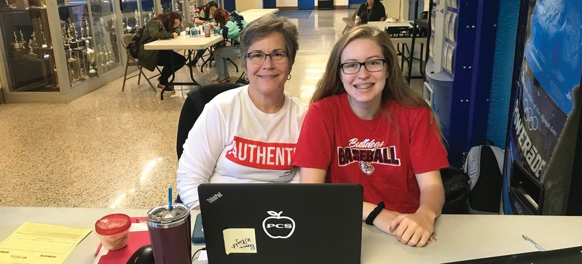 Pennie Wright is seen here with Paige Mangum, as they check in students to donate their pint of blood. ASHETON MEDLIN | THE ROCK