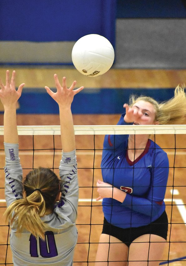 Person's Emma Duncan takes a big swing during the second set of Tuesday's match against Northern Guilford. The Rockets will travel to McMichael Thursday. KELLY SNOW | COURIER-TIMES