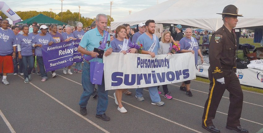 The Survivor Lap featured hundreds of cancer survivors who took a ceremonial first lap around the track, led by an honor guard made up of Person County Sheriff's deputies. PHOTOS BY JOHNNY WHITFIELD