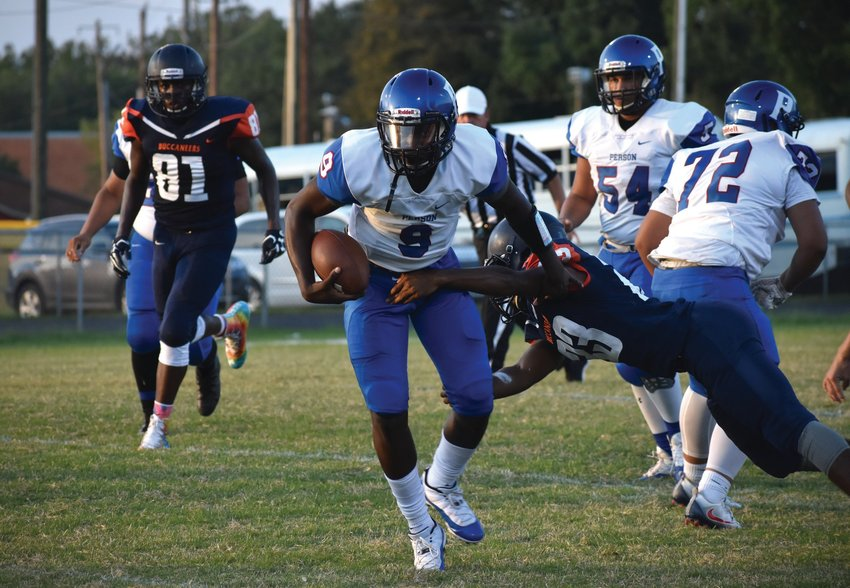 Person quarterback Malik Williams eludes a Bartlett Yancey tackler during Friday's game. KELLY SNOW | COURIER-TIMES