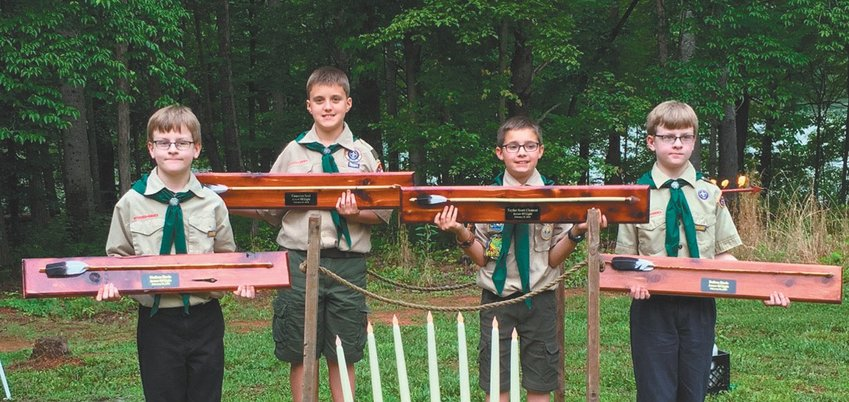 """The Cub Scouts who received their Arrow of Light Award were (left-to-right): Nathan Davis, son of Jim and Sharon Davis; Cameron Seal, son of John and Marcia Seal; Taylor Clement, son of Christopher """"Kit"""" and Jennifer Clement; and Dalton Davis, son of Jim and Sharon Davis. SUBMITTED"""