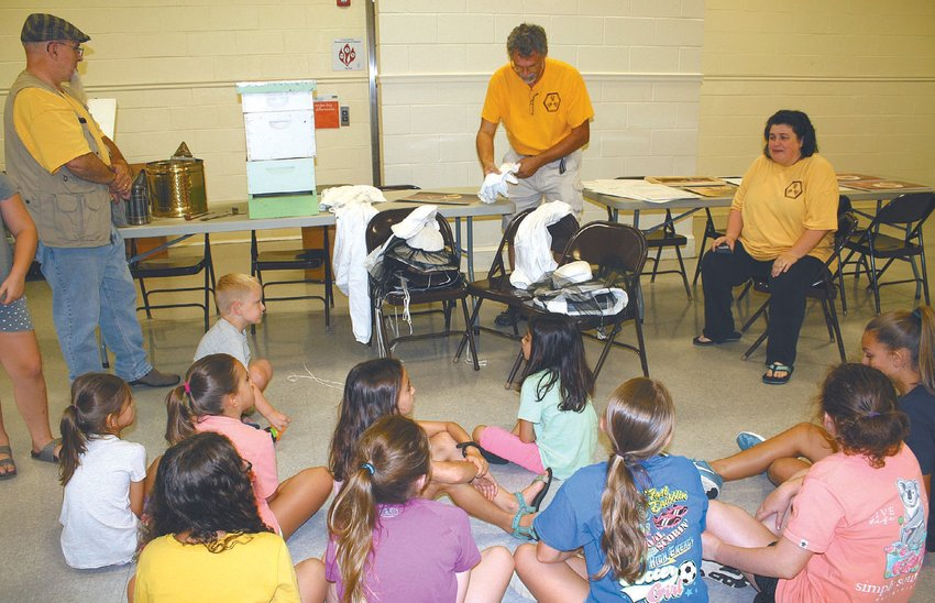 Person County beekeepers Chris Bradley, left, Reid Coyner and Whitney Barnes talk to participants about protective beekeeping equipment. ALL PHOTOS ARE SUBMITTED