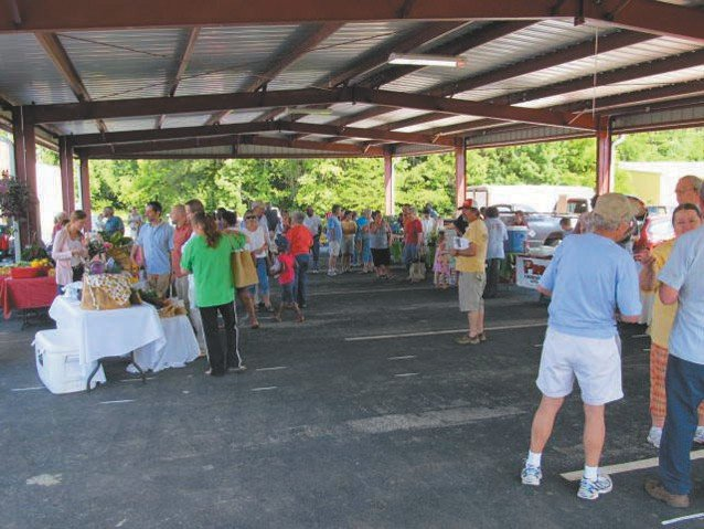 Vendors and customers fill the pavilion on a busy Saturday morning. SUBMITTED