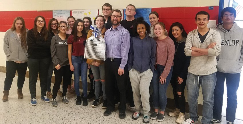 Person High School Teacher of the Year Greg Turner is shown here with students.