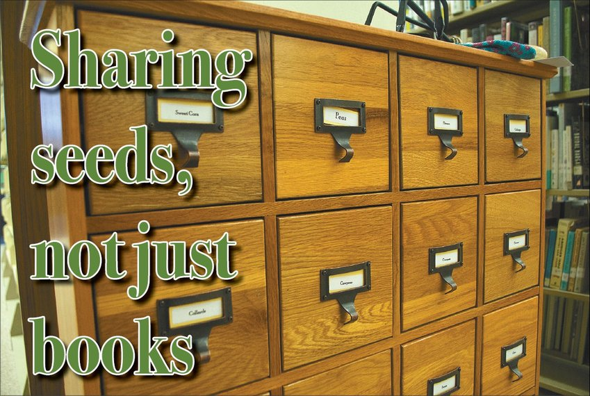 The new seed library, located inside the Person County Public Library, organizes plant types, such as tomatoes and beans, into drawers. The drawers are then further categorized by plant variety, such as Brandywine tomatoes and Turkey Craw Pole beans.