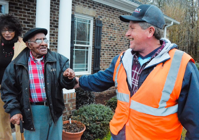 Roger Jeffers (middle) loves to ride PATS. He says when drives blow the horn, it feels like he is in heaven. When transportation specialist Mark Ellis (right) picked up Jeffers from the Person County Senior Center, they were laughing and  joking on their way to the bus. Irene Jeffers assisted and was laughing at their jokes.