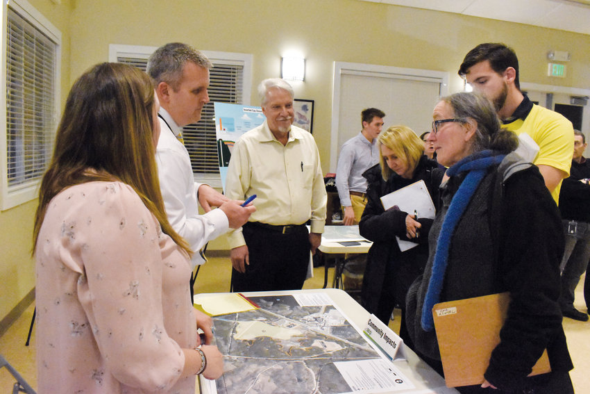 Tuesday night North Carolina Department of Environmental Quality held a public drop-in session to give the public a chance to weigh in on Duke Energy's plans to close coal ash basins on the power plant property and to ask questions about the process.