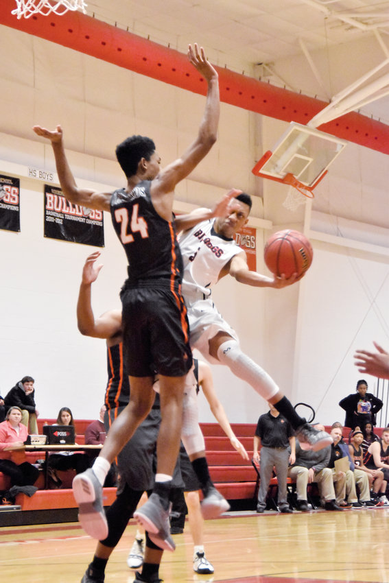 Kelly Snow | The Courier-Times.Roxboro Community School guard Jalen Bailey scored 21 points in Tuesday's game against Falls Lake Academy. Bailey tried to score this off-balanced shot around Firebird defender Nate Taylor.