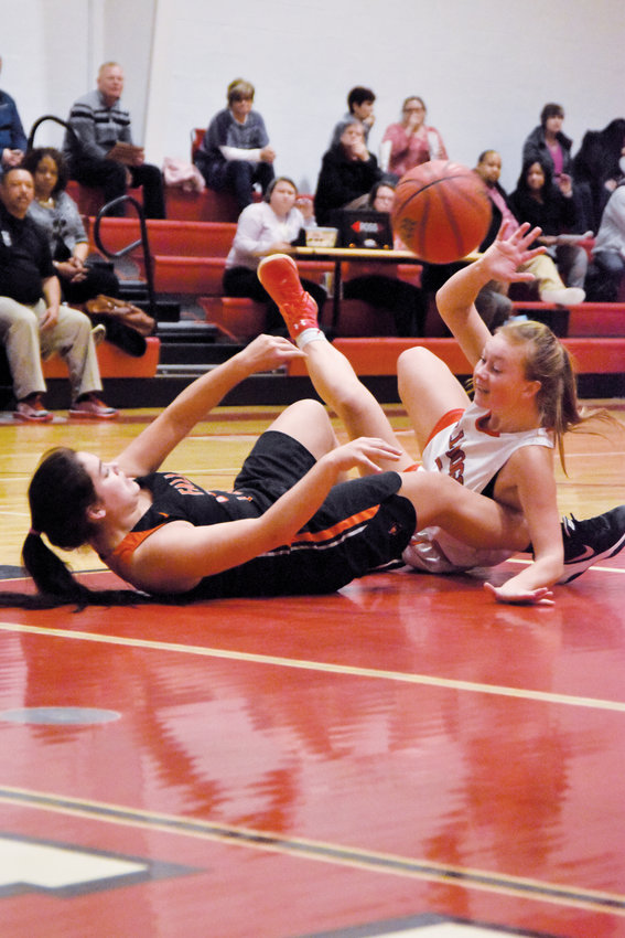 Kelly Snow | The Courier-Times.Roxboro Community School senior Mackenzie Oliver goes after a loose ball during the second half of Tuesday's game against Falls Lake Academy.