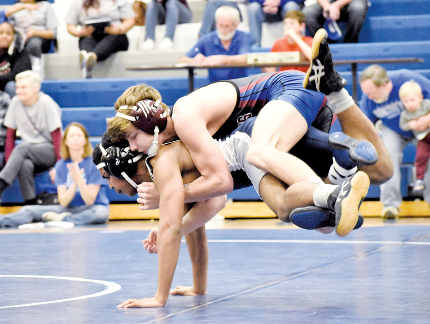 Kelly Snow | The Courier-Times.Person's Landon Moser tries to hang on during the first period of his match Wednesday against Northeast Guilford.