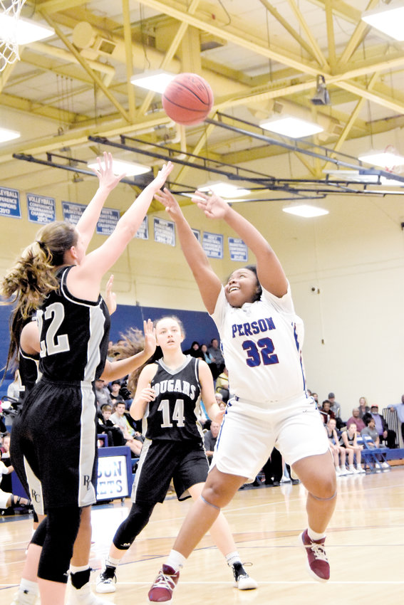 Kelly Snow | The Courier-Times.Person's DaNiya Richardson lofts a shot over a defender during a recent game..