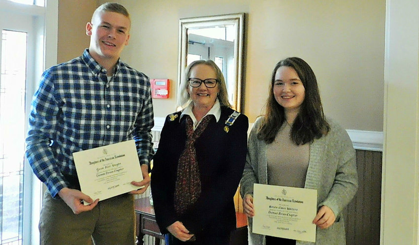 Jacob Vaughn, left, and Natalie Walters, right, were recognized by DAR member Pam Wood and other members of the organization as winners of the organization's Good Citizen Awards.
