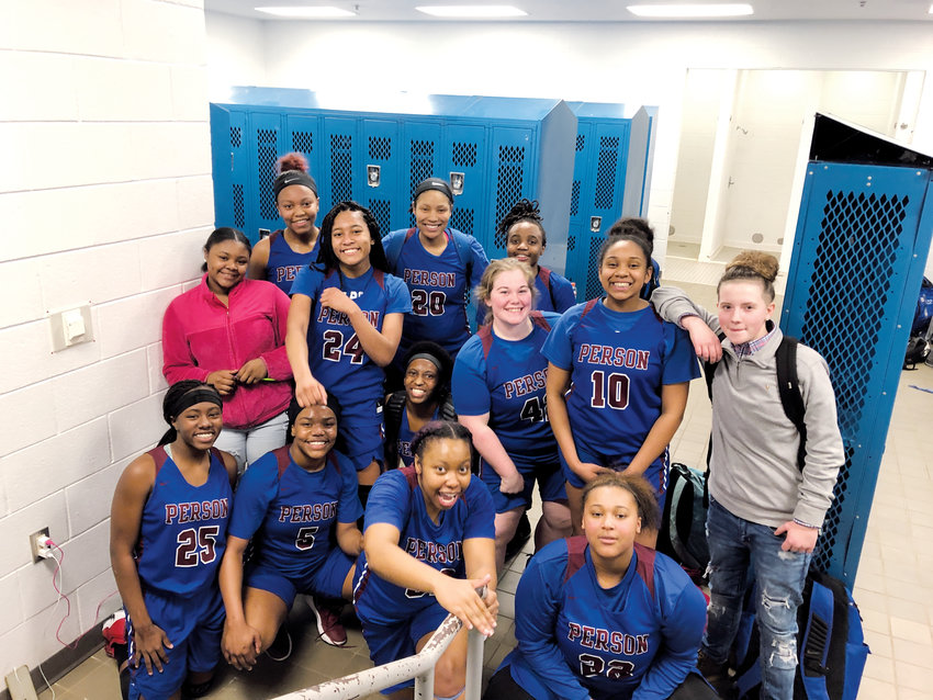 The Person High School girls' basketball team is all smiles after defeating Northeast Guilford, 48-38, to clinch the Mid-State Conference regular season championship. It was the program's first regular season conference title since 1990 and first as a member of the Mid-State.