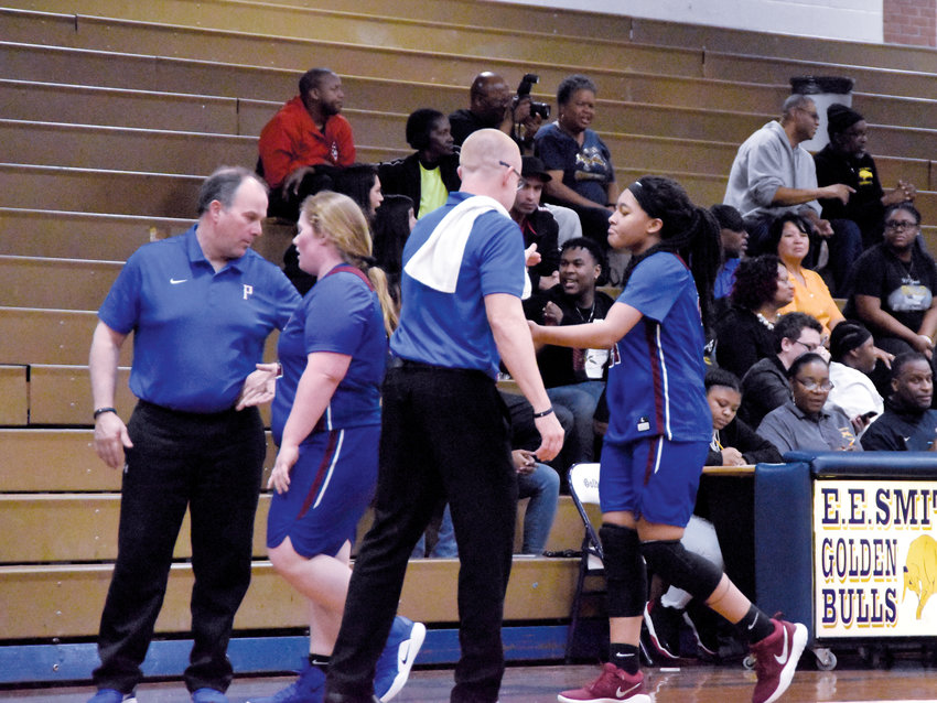 Kelly Snow | The Courier-Times .Person girls basketball coaches Jay Carmichael and Jeff Mangum console players in the waning moments of the Rockets' loss to E.E. Smith in the third round of the 3A state playoffs.