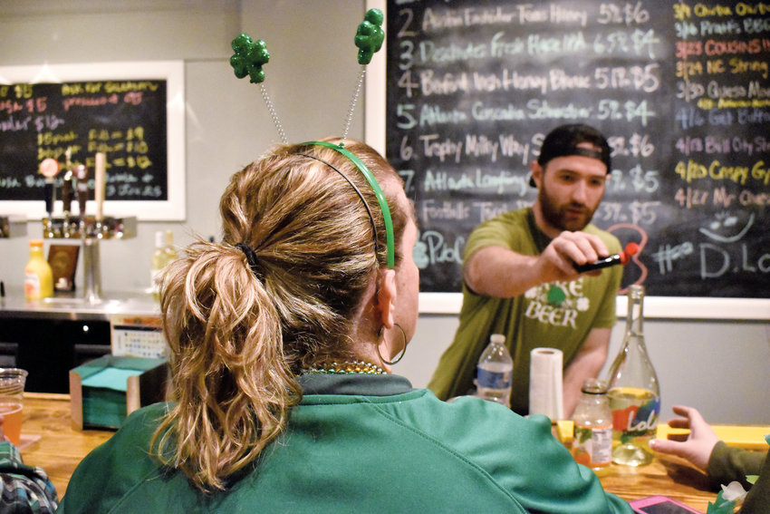 Uptown Roxboro First Pub Crawl brought out the Irish in Person County residents. Hunter Moss was busy serving patrons of 1792 Beer Company with all manner of Irish brews.