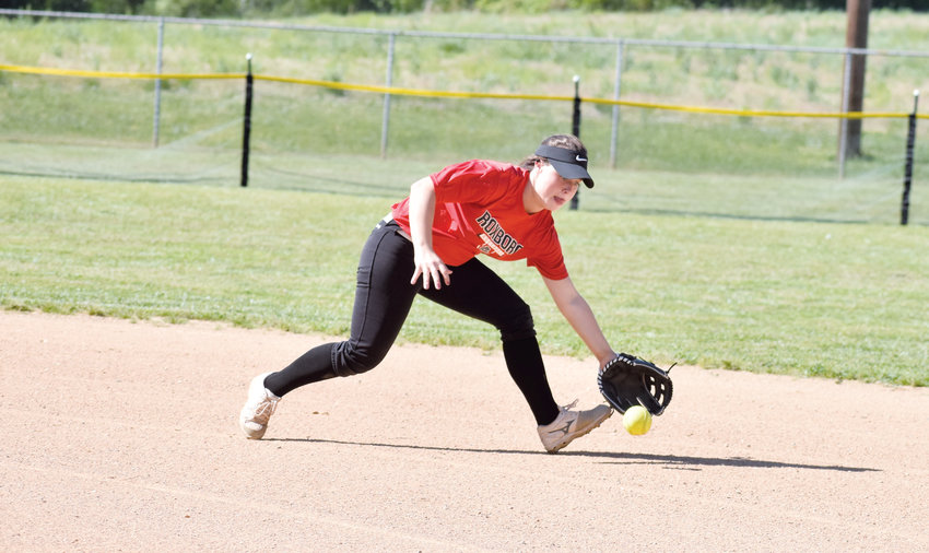 Kelly Snow | The Courier-Times.Karsin Lee reaches out to make the play on a grounder during Roxboro Community School's game against Franklin Academy..