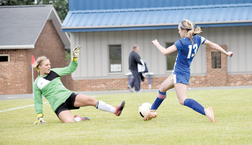 Kelly Snow | The Courier-Times.Person's Abby Mayer and Rockingham County keeper Reanna Wilmouth go one-on-one in front of the Cougars' goal during the first half of Monday's game.