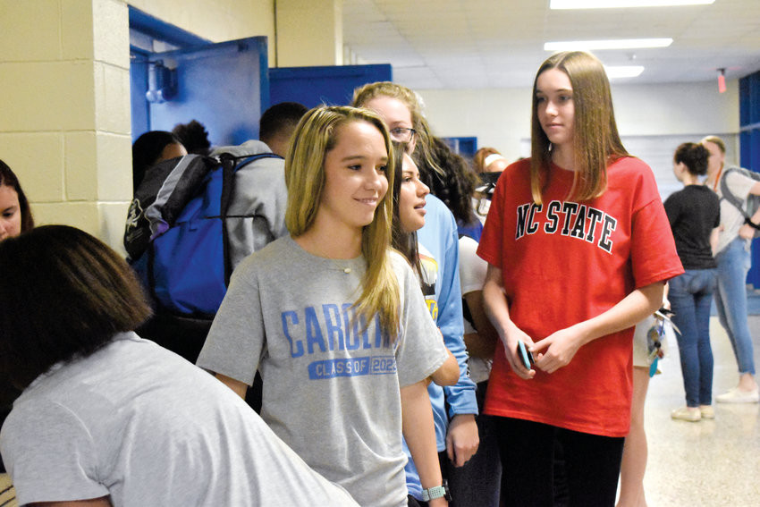 Magen Elliott, left, and Grayson Cothran wait for refreshments after Decision Day activities at Person High School on Friday.