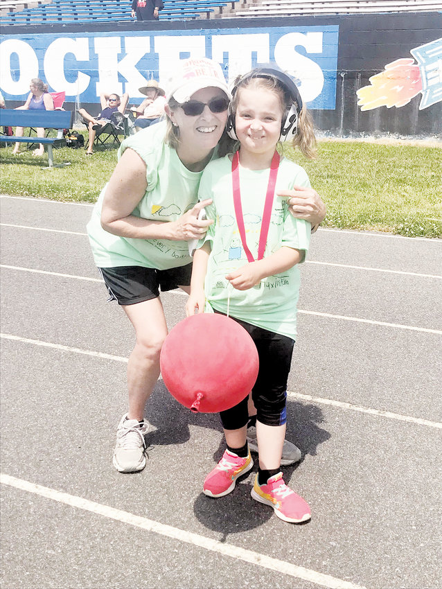 Makita Anderson | The Rock.Sarah Wrenn is pictured with her daughter Gabby, who participated in Special Olympics on Wednesday, May 8.