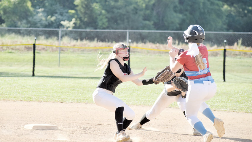 Kelly Snow | The Courier-Times.Roxboro Community School shortstop Kelcey Mangum tags North Stanly's Callie Parker on a steal attempt during the sixth inning of Friday's second-round playoff game. Catcher Maci Clark threw out Parker.