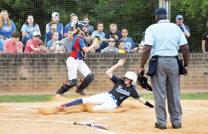 Kelly Snow | The Courier-Times.Person's Taylor Sullivan slides home safely in the third inning of the team's second-round playoff game at Southern Alamance. The Patriots rallied for a 3-2 victory Friday in Graham.