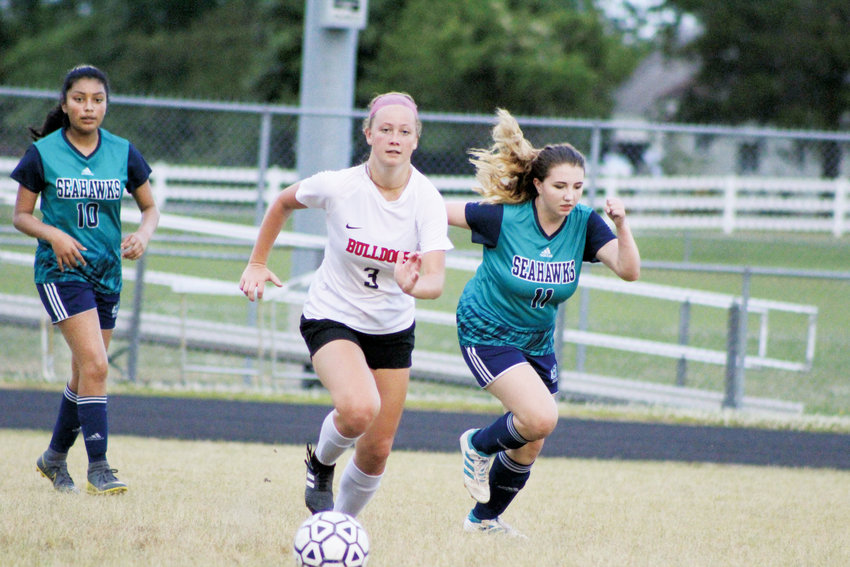 Contributed Photo.Roxboro Community School's Mackenzie Oliver scored four goals in the Bulldogs' 8-0 victory at Southside in the second round of the 1A state playoffs. The Bulldogs will travel to East Carteret Wednesday for the third round.