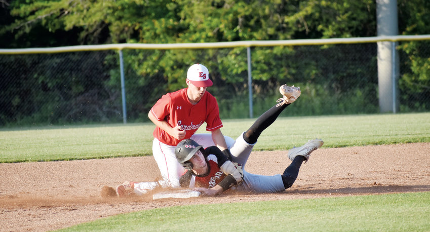 Kelly Snow | The Courier-Times.Roxboro Community School senior Ian Coleman successfully steals second base in the first inning of Friday's game at East Surry. Coleman swiped four bases and scored twice in the Bulldogs' 4-1 win at East Surry in the fourth round of the 1A state playoffs..