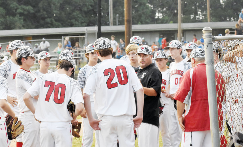 Kelly Snow | The Courier-Times.Roxboro Community School coach Pete Tuck addresses the team before the home half of the fourth inning during Thursday's second game of the 1A west regional finals.
