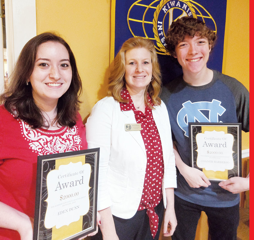 Roxboro Kiwanis Club scholarship winners Eden Dunn, left, and Conner Barberio, right, are pictured with guest speaker Sherry WIlborn, Person County's economic development director.