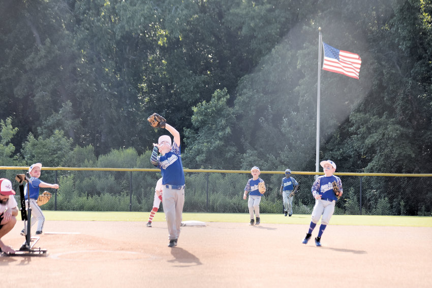 Jack Frederick | Wilson Times.Person County 8U Little League All-Star Ethan Loftis catches a flyball during a district tournament game earlier this summer. The All-Stars will play in the state tournament this weekend in Wilson.