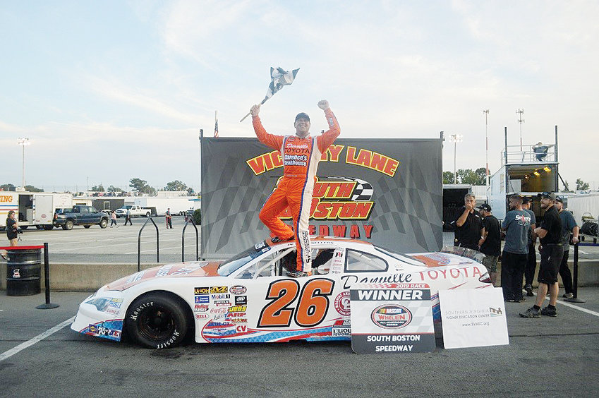 Peyton Sellers of Danville, Virginia celebrates in Victory Lane following his win in the first of Saturday night's pair of 75-lap NASCAR Whelen All American Series Late Model Stock Car Division races at South Boston Speedway. Sellers swept the twinbill and now has six wins at the track this season.
